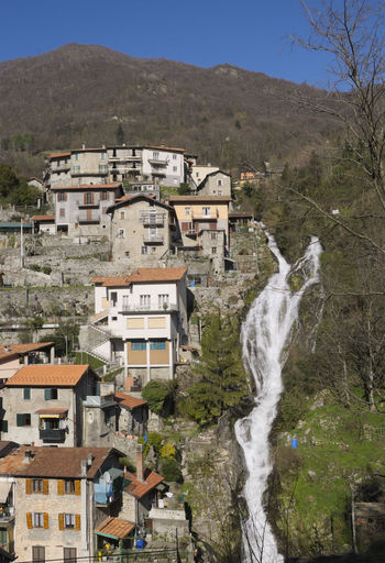 Orrido di Nesso waterfall, Nesso, Lake Como, Italy Como Lake Houses Nesso Scenic Beauty In Nature Building Exterior Day Environment Europe Flowing Water House Italy Lake Como Mountain Nature No People Orrido Outdoors Ravine Scenery Scenics Scenics - Nature Village Water Waterfall