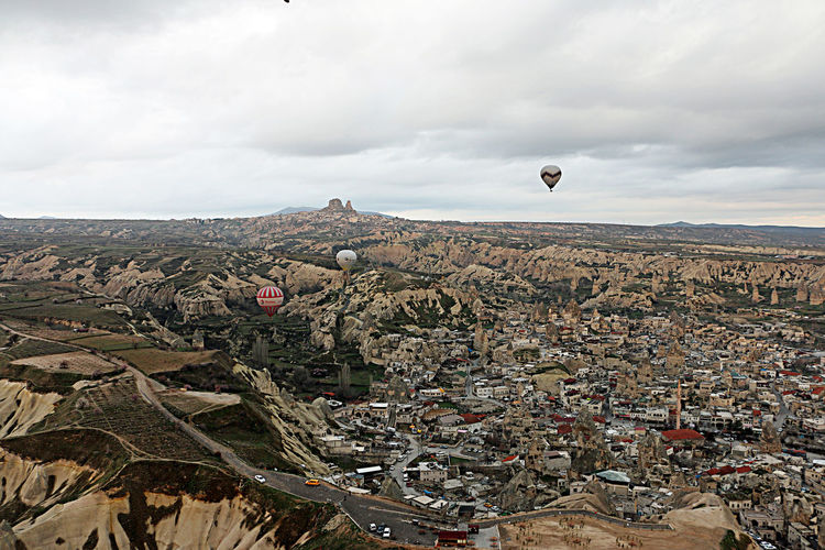 Aerial View Cappadocia Hot Air Ballons City Cityscape Day Flying Hot Air Balloon Landscape Outdoors Sky Travel Travel Destinations
