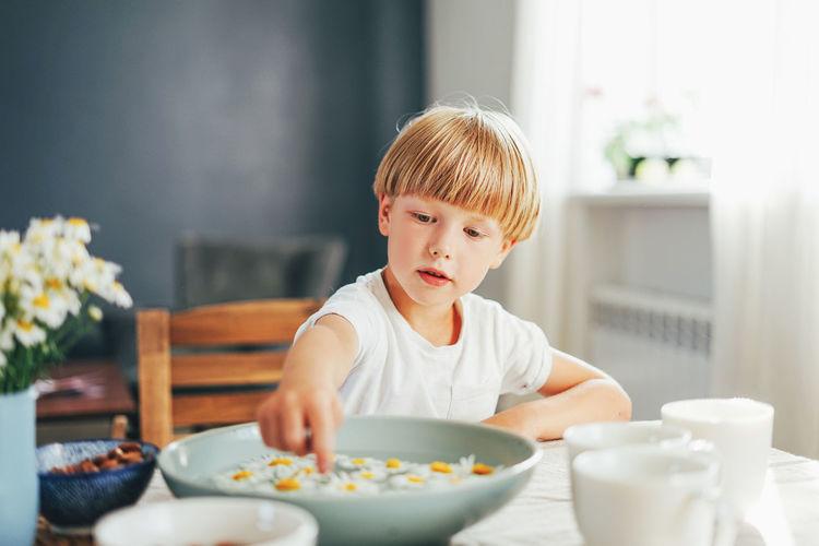 Boy sitting on table