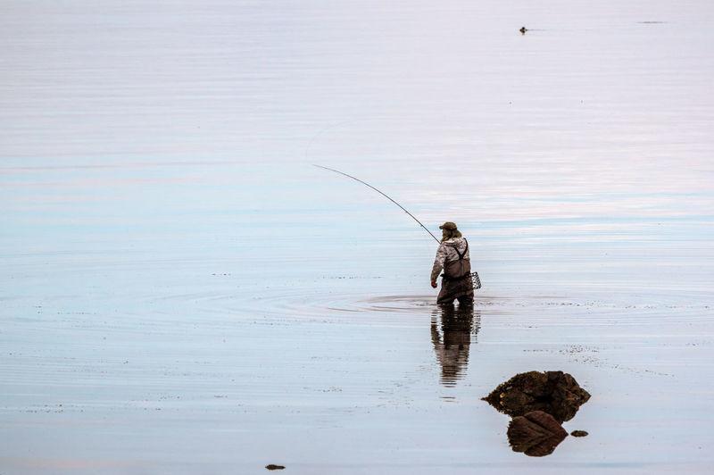 Man fishing in a sea