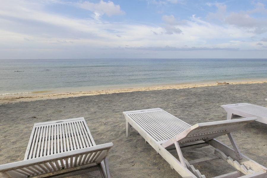 Beach chairs at Gili Trawangan Indonesia. Beach Beauty In Nature Chairs Day Gili Trawangan Horizon Over Water Lombok Indonesia Nature No People Outdoors Sand Scenics Sea Sky Tranquility Water