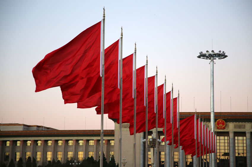 Red flags waving on Tian'anmen Square in Bejing, China. Architecture Beijing Changing Of The Guards China City Day Flag Gate Of Heavenly Peace Horizontal Military No People Outdoors Patriotism Red Sky Tian' Tian'anmen Square Wachablösung Great Hall Of The People Große Halle Des Volkes Red Flag Red Flags Low Angle View Red