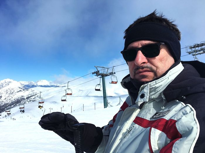 Snow Winter Cold Temperature Sky Weather Sunglasses This Is Masculinity Leisure Activity Real People Young Adult One Person Skiing Day Outdoors Lifestyles Young Men Ski Goggles Cloud - Sky Low Angle View Mountain Ski Holiday This Is Aging