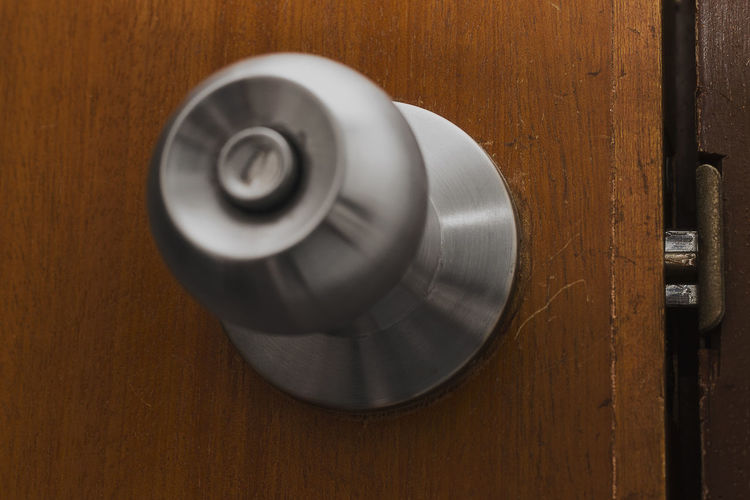 Peace At Last Room Wood Grain Circle Close-up Directly Above Door Door Handle Doorframe Geometric Shape Indoors  Knob Lock Man Made Man Made Object Metal Metal Handle No People Shape Silver Colored Single Object Stainless Steel  Still Life Wood - Material Wood Grain Texture Wooden Door