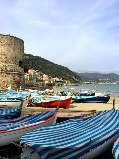 Laigueglia Sunlight Tower Seascape Water Tourism Clouds Old Travel Destinations Striped Covering Sand Coastline Mountain Castle Italy Laigueglia Boat Water Nautical Vessel Sky Sea Transportation Nature Moored Day No People Beach Harbor Rowboat Mode Of Transportation