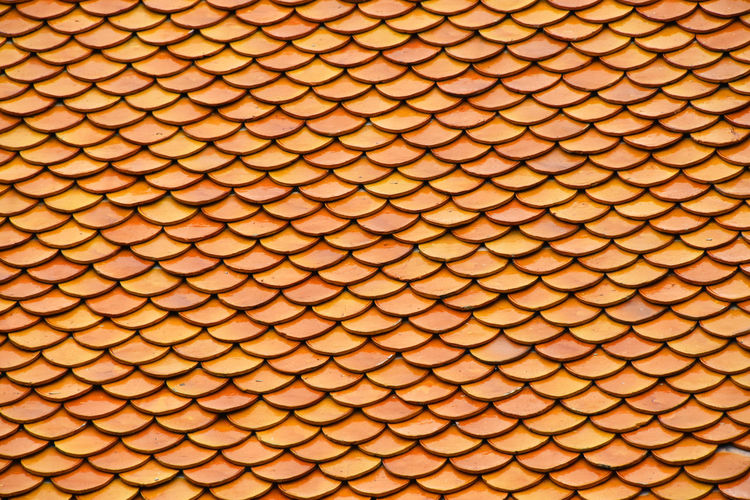 Orange ceramic roof tiles Architectural Detail Architecture Asian  Brown Ceramic Decor Decoration Decorative Details Religious Architecture Roof Roof Tile Roofs Rooftop Rooftops Spotted In Thailand Thai Thailand Tiles Yellow