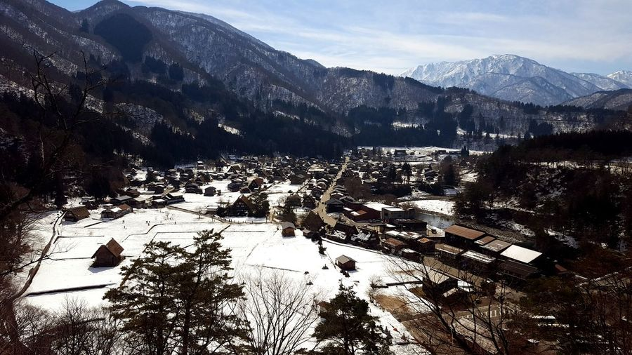High angle view of townscape and mountains during winter