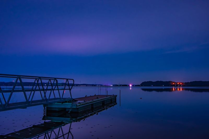 Orange Color Calm Silent Fantasy Countryside Water Sky Scenics - Nature Reflection Night Beauty In Nature Blue Nature No People Sea Cloud - Sky Waterfront Purple Pier