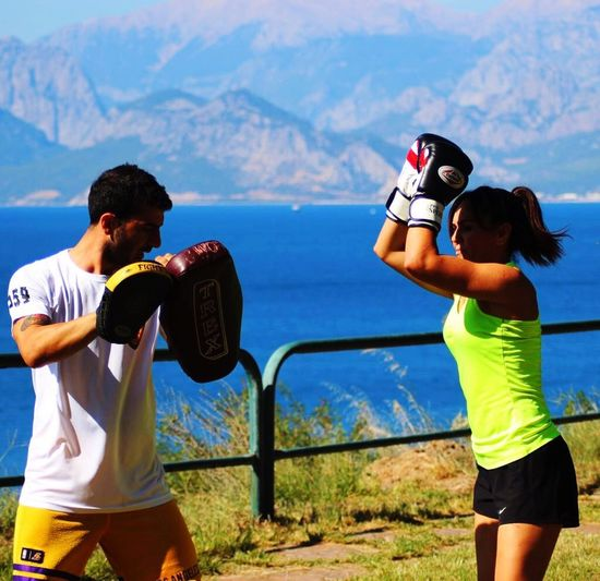 Two People Adult Nature Togetherness Activity Leisure Activity People Lifestyles Women Motion Men Landscape Mountain Outdoors Water Friendship Young Adult Sky Day Adults Only Kickboxing