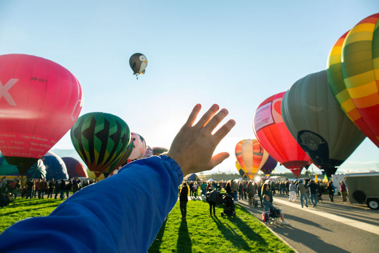 People in hot air balloons against sky