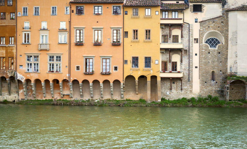 Ancient houses overlooking the Arno river in Florence, Italy Facades Building Water Lungarno Florence Italy Florence Arno  Famous Architecture Building Exterior Built Structure Canal City Day Florence No People Outdoors River Tourism Tourism Destination Travel Destinations Water Waterfront Window Stories From The City