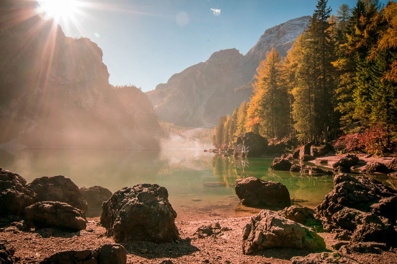 Scenic View Of Lake Braies And Mountains Against Sky During Autumn