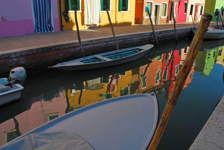 Boats moored in swimming pool at canal