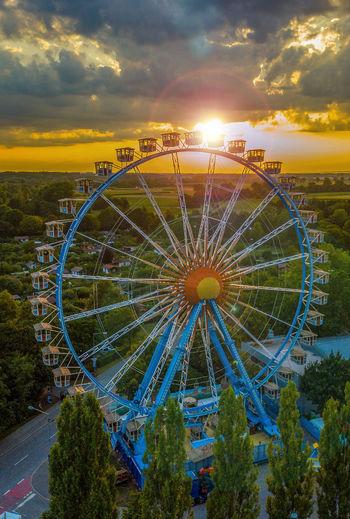 Ferris wheel against sky during sunset