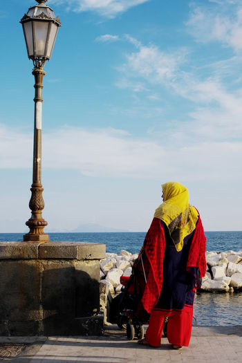 Rear View Of Woman In Sari Standing By Sea Against Blue Sky Dress India Indian Naples The Street Photographer - 2018 EyeEm Awards Tradition Clothing Culture Day Horizon Horizon Over Water Italy Lifestyles Looking At View Nature Outdoors People Real People Rear View Sari Sea Sky Water Women Summer In The City The Art Of Street Photography