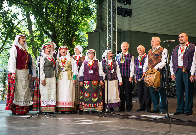 RIGA, LATVIA - JULY 03: Singing people in national costumes at the Latvian National Song and Dance Festival on July 03, 2013. Holiday was hold from 30th June 2013 till the 7th July 2013. The Song and Dance Celebration has also been included in the UNESCO List of the Intangible Cultural Heritage of Humanity Artist Event Holiday Latvia Latvian National Song And Dance Festival National Holiday Singing Song And Dance Festival Summertime Capital Cities  Concert Cultural Cultural Art Cultural Dance Culture Europe Festival Folk Human Latvian Northern Europe Outdoors People Riga Summer