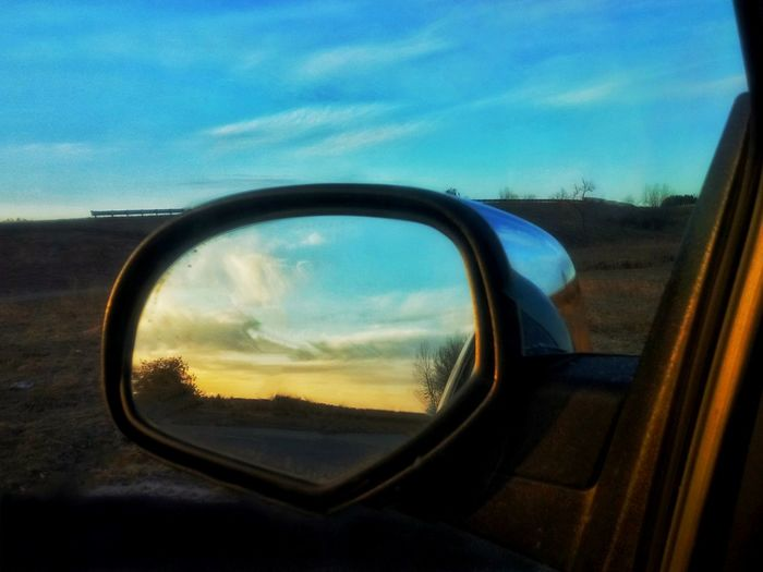 View of side-view mirror of car