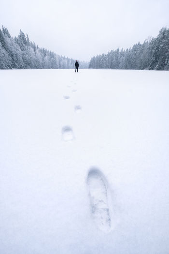 Winter landscape with footprint and lonely man at mood daytime in Finland. Snow Winter Cold Temperature Nature Tree Scenics - Nature White Color Beauty In Nature One Person Covering Field Tranquil Scene Tranquility Leisure Activity Environment Day People Men FootPrint Landscape Nature Finland Lonely Alone Selfie