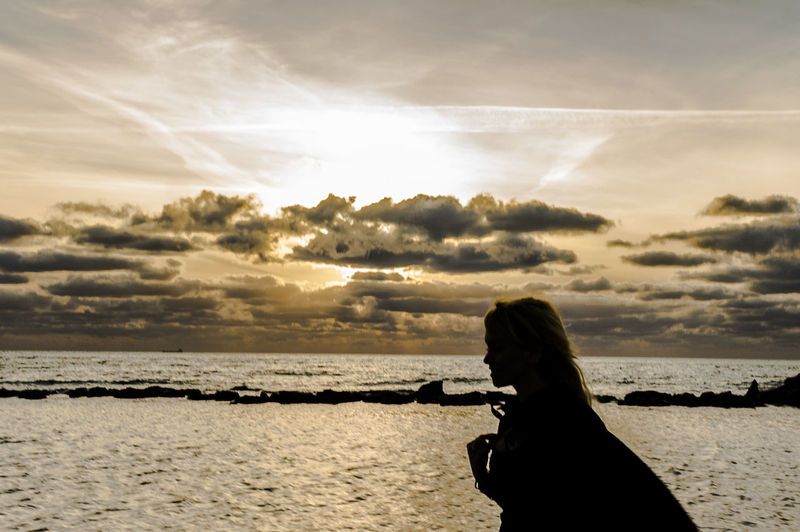 Ray of light Adult Adults Only Beach Beauty In Nature Cloud - Sky Day Horizon Over Water Nature One Person One Woman Only Only Women Outdoors People Rear View Scenics Sea Silhouette Sky Sunset Water Young Adult