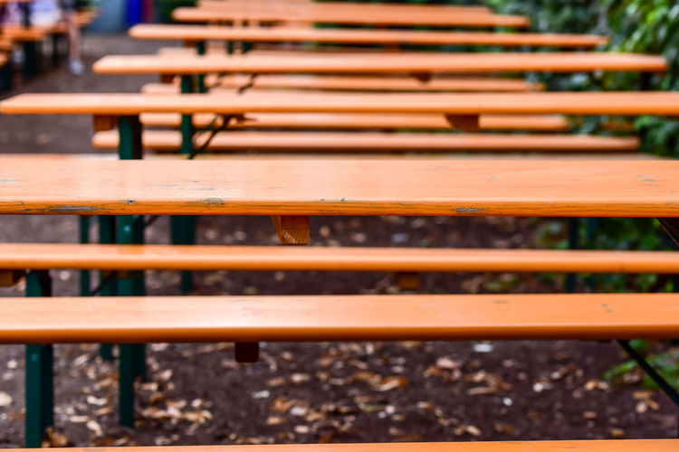 Close-up of empty bench in row