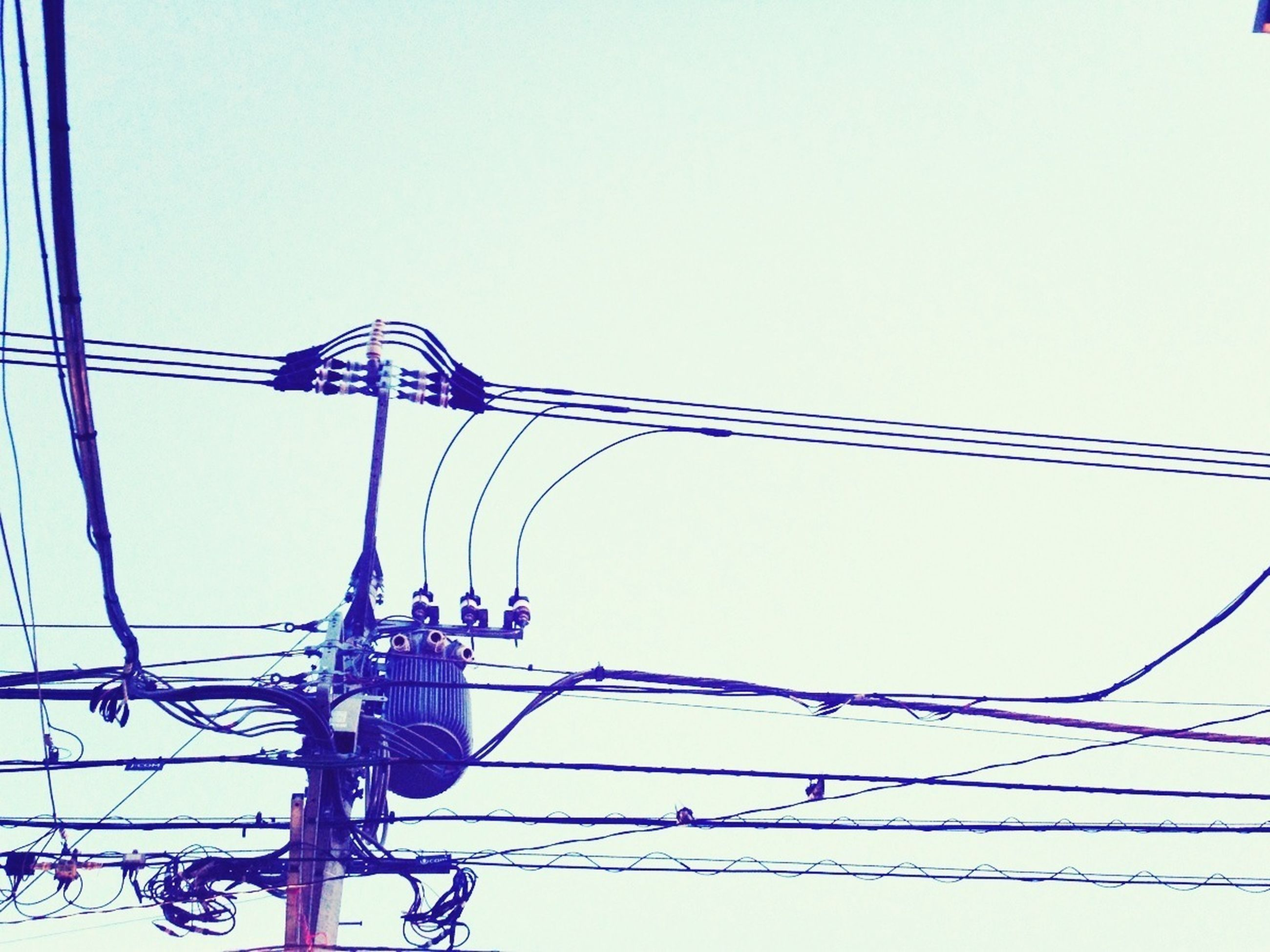 clear sky, low angle view, copy space, blue, connection, cable, power line, built structure, electricity, metal, architecture, day, technology, electricity pylon, power supply, outdoors, no people, high section, street light, protection
