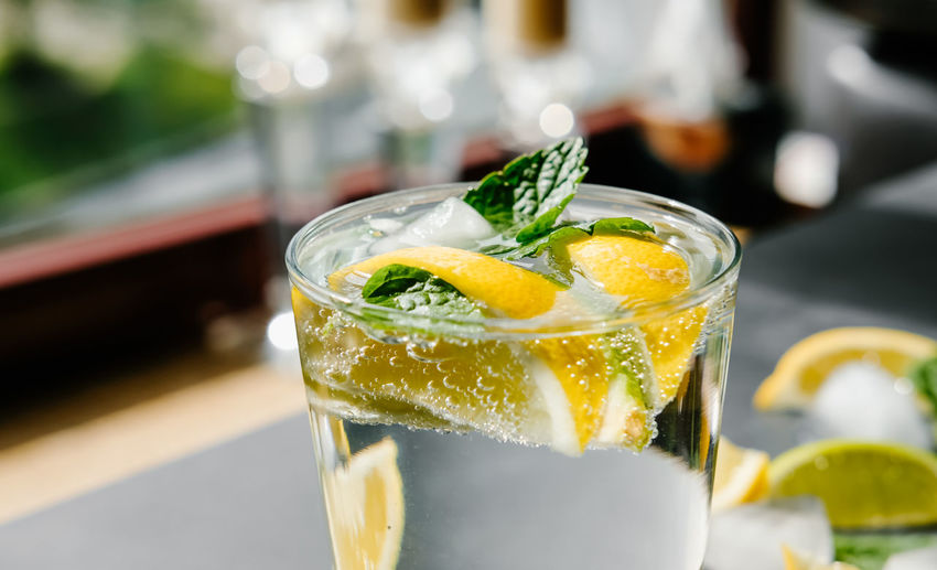Refreshing iced infused water with lime, lemon and mint. summer drink, cocktail concept.