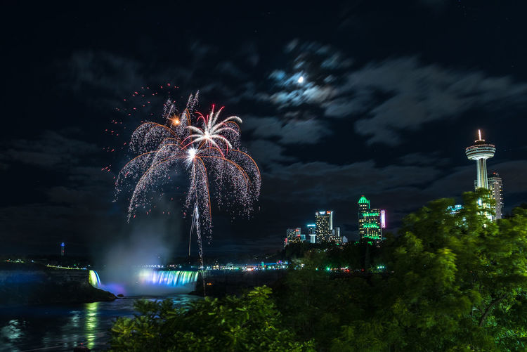 Niagara Falls Fireworks Fireworks Fireworks Display Fireworks With Moon Horseshoe Falls Multi Colored Falls Multi Colored Falls Niagara Falls Canada Architecture Building Exterior Built Structure Celebration City Cityscape Event Firework Firework - Man Made Object Firework Display Long Exposure Low Angle View Multi Colored Night No People Outdoors Sky Water Go Higher