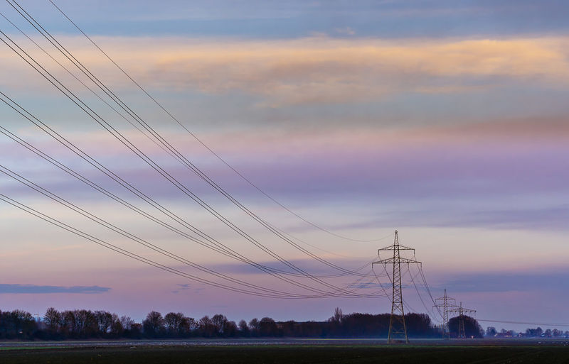 Power lines Beauty In Nature Cable Cloud - Sky Connection Day Electricity  Electricity Pylon Landscape Nature No People Outdoors Power Line  Scenics Sky Sunset