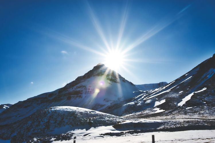 Snow Winter Mountain Cold Temperature Sky Sunbeam Sun Sunlight Lens Flare Scenics - Nature Beauty In Nature Mountain Range Sunny Nature Snowcapped Mountain Tranquil Scene Tranquility Bright Environment No People Mountain Peak Solar Flare