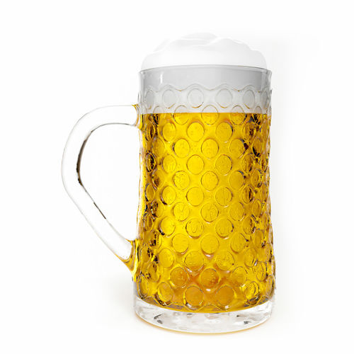 Close-up of beer glass against white background