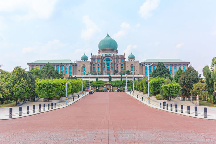 Malaysian Prime Minister's office in Putrajaya, It is a planned city, 25 km south of capital, serves as the federal administrative centre of Malaysia. Architecture Building Exterior Built Structure Cloud - Sky Day Dome Goverment Building Landmark Landscape Malaysia Muslim No People Outdoors Palace Place Of Worship Prime Putrajaya Religion Sky Spirituality Travel Destinations Tree