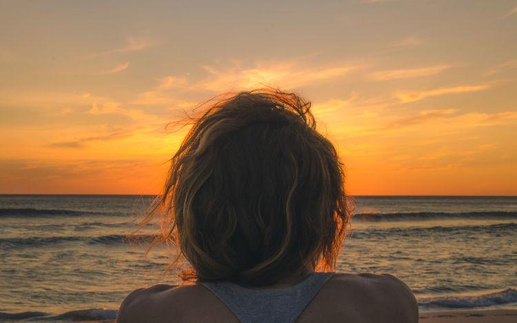 Beach Beach Hair Beach Life Blond Hair Brown Hair Contemplating Curly Hair Hair Headshot Messy Hair Nosara Ocean People Rear View Scenics Sea Summer Nights Sungazing Sunset Travel Destinations Unplug Warm Weather Warmth Watching The Sunset Woman Miles Away