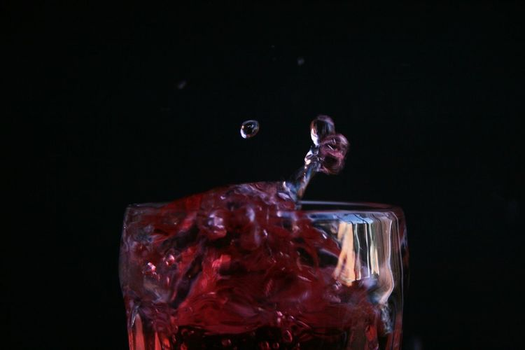 Red Soda Black Background Close-up Day Drink Drinking Glass Freshness Glass High-speed Photography Motion No People Splash Studio Shot Water