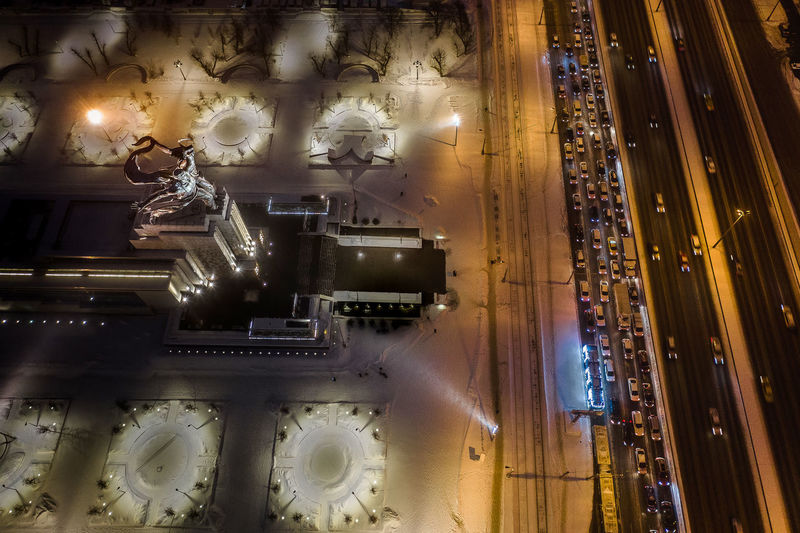 Digital composite image of illuminated lighting equipment in city