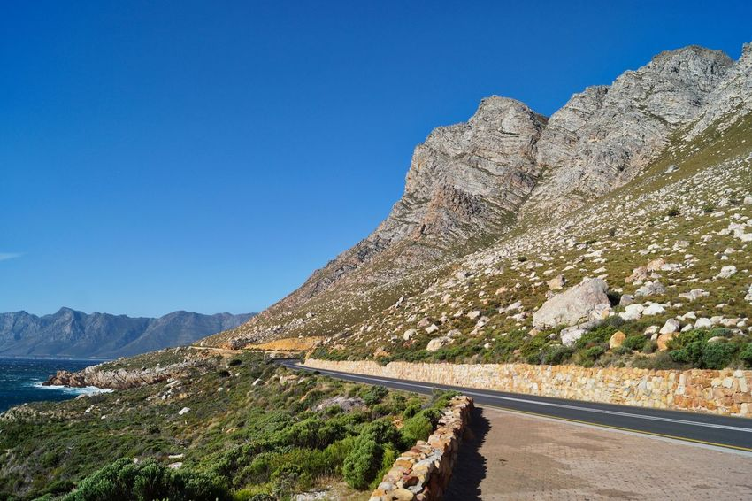 Mountain Scenics Sunny Outdoors Sky Nature Landscape Blue Mountain Range No People Clear Sky Travel Destinations Day Tree Tranquility Beauty In Nature Water False Bay Cape Town Cape Town, South Africa Vacations Cliff Wave Clear Sky Nature