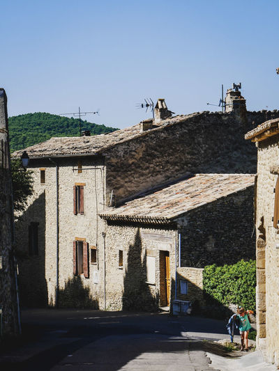 Faucon Provence Provence Alpes Cote D´Azur Architecture Building Building Exterior Built Structure City Clear Sky Copy Space Day Faucon  Girl House Incidental People Nature Outdoors People Real People Residential District Road Shadow Sky Street Sunlight The Way Up