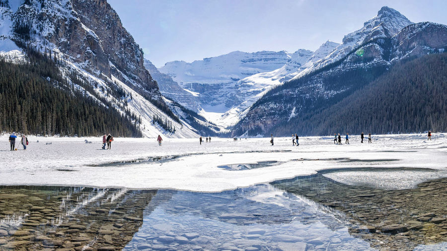 The melting Lake Banff  Banff National Park  Lake Louise,Alberta Beauty In Nature Canada Cold Temperature Group Of People Mountain Mountain Range Scenics - Nature Snow Winter