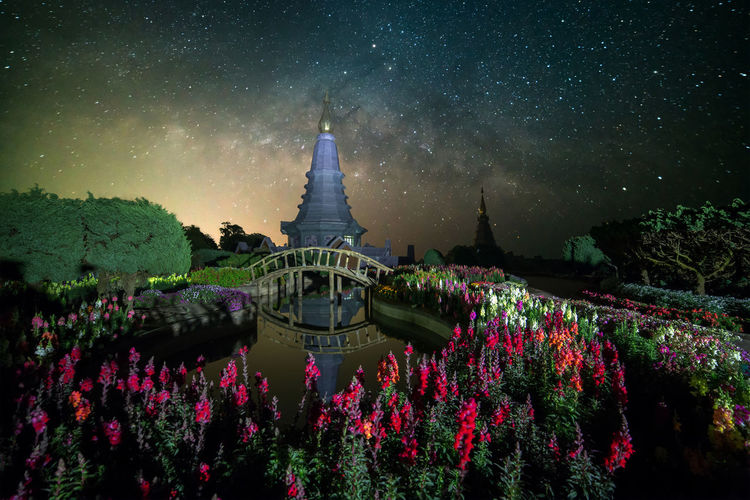 Pagoda in doi inthanon national park at night against star field