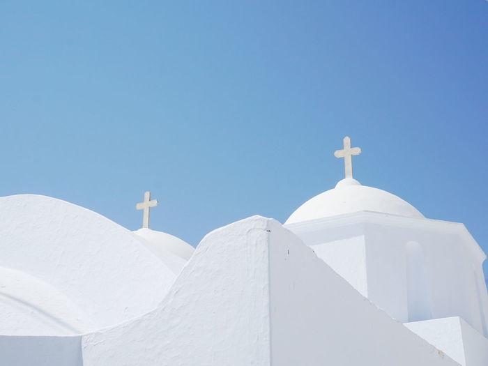 White greek church against clear sky
