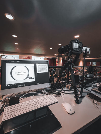 Low angle view of illuminated lighting equipment on table