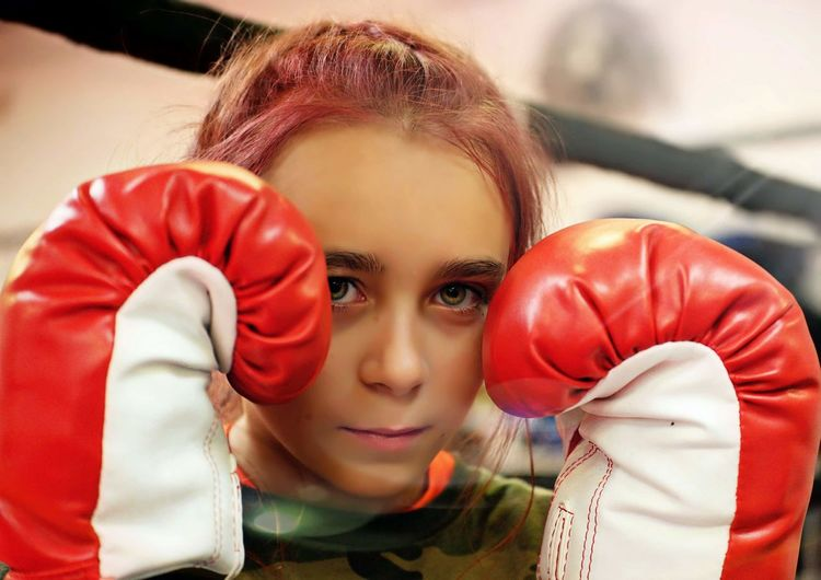 Close-Up Portrait Of Girl Wearing Boxing Glove