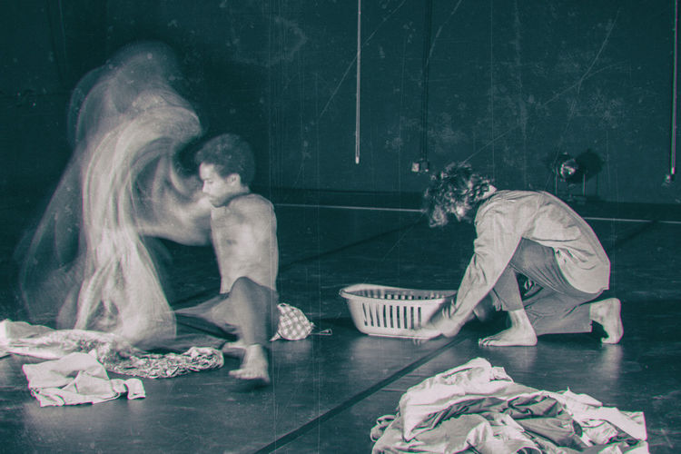 Men Doing Laundry While Performing On Stage