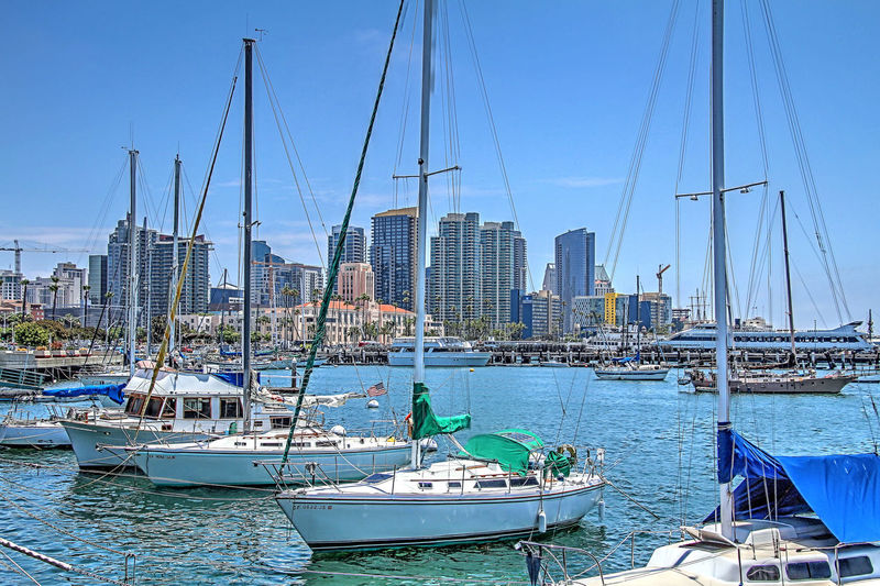 San Diego Bay and the Embarcadero. San Diego, California, Bay, Embarcadero, Waterront, City, Cityscape, Skyline, Waterfront, Harbor, Sailboats, Yachts, Highrise, Buildings, Sails, Swimming, Canoe, Waater Sports, Water Nature
