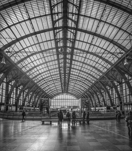 People walking in railroad station