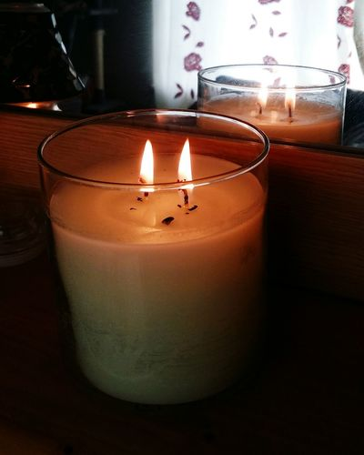 A Double Wick Candle . Taken In Front of a Mirror . You can see the Candle Light of the Two Wicks Reflecting so it looks like Four Flames