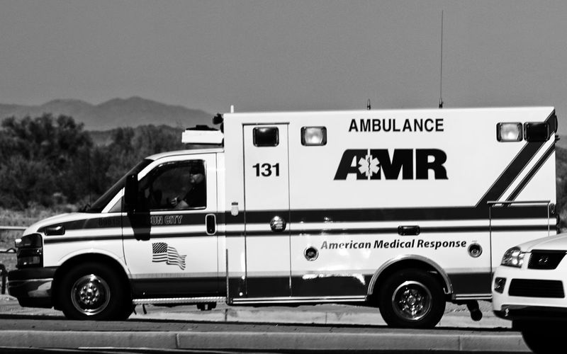 American Medical Response Ambulance Amr Clear Sky Day Fire Engine Full Length Land Vehicle Mode Of Transport No People Occupation Outdoors Police Force Protection Safety Sky Text Transportation