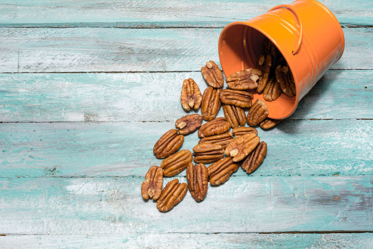 Closeup on shelled pecans. Background of organic pecan nuts selective focus. Healthy food Pecan Close-up Day Food And Drink No People Walnut Wood - Material