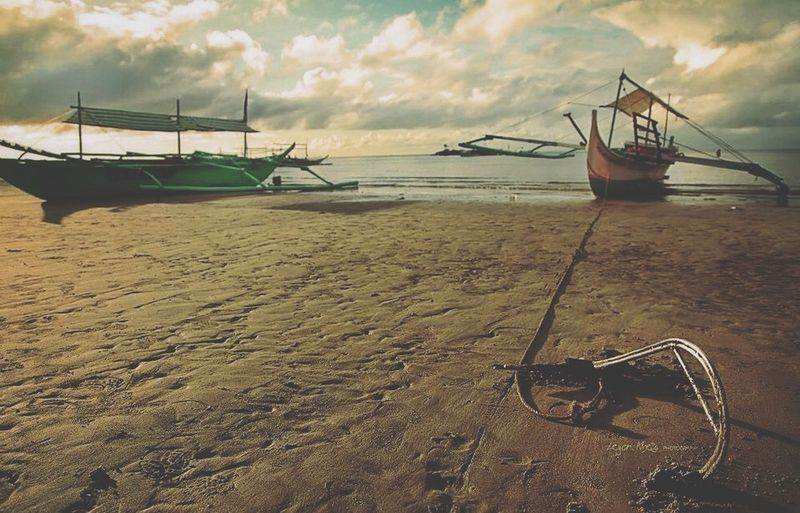 Anchored Leyonphotography Laiya Batangas Philippines Laiya Beach Water Sea Beach Nautical Vessel Cloud - Sky Transportation Sand Nature Sky Mode Of Transport Moored Outdoors Horizon Over Water Beauty In Nature Scenics Fisherman Outrigger Longtail Boat Day