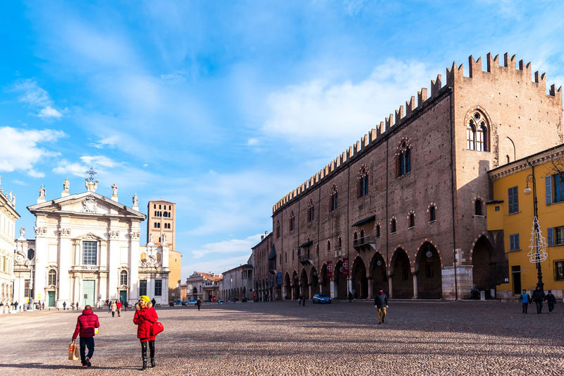 Mantova, Italy - January 5 2018 : Historical city of Mantua. Ducal Palace. Square of herbs. Architecture Building Exterior Built Structure Group Of People Sky Real People Women Building Crowd Cloud - Sky Men Adult The Past History Travel Destinations Nature Lifestyles Outdoors Mantua Italy Travel Ducal Palace