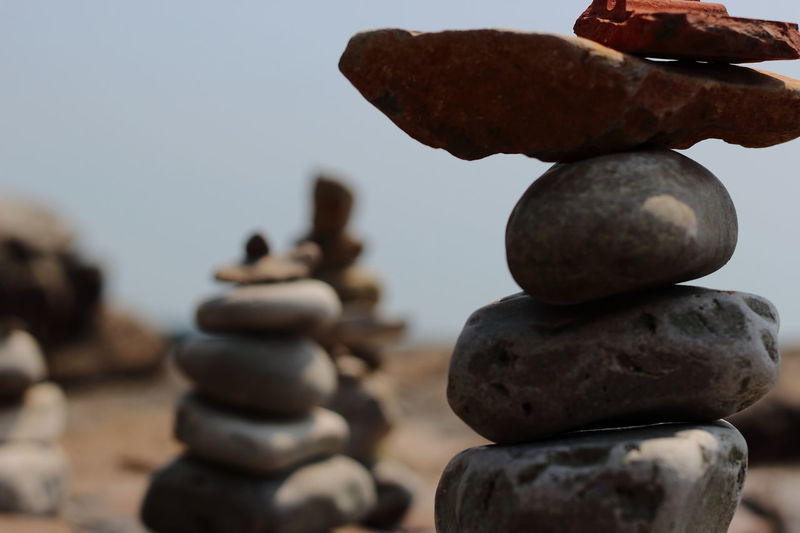 Arrangement Backgrounds Balance Beach Chess Chess Piece Close-up Copy Space Day EyeEm Best Shots EyeEmNewHere Focus On Foreground Knight - Chess Piece Large Group Of Objects No People Ocean Outdoors Pebble Rock Rock - Object Sea Stack Strategy